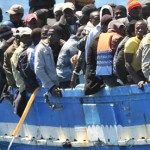 A boat full of migrants arrives at the Italian island of Lampedusa in April 2011
