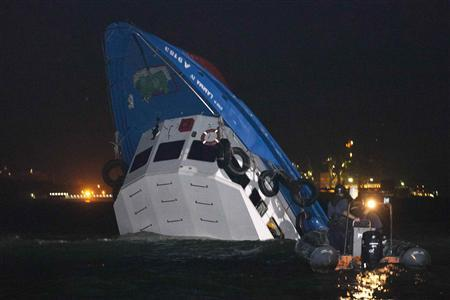 Rescuers approach a partially-submerged boat after two vessels collided in Hong Kong