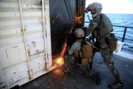 Critical Skills Operators with Bravo Company, 1st Marine Special Operations Battalion, U.S. Marine Corps Forces Special Operations Command, saw through a steel door during Visit, Board, Search and Seizure training near Naval Base Coronado, Calif., Jan. 15. (Official Marine Corps photo by Sgt. Donovan Lee/released)
