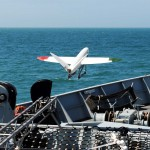 "A 3D printed aircraft has successfully launched off the front of a Royal Navy warship and landed safely on a Dorset beach.    HMS Mersey provided the perfect platform for the University of Southampton to test out their SULSA unmanned aerial vehicle (UAV).    Weighing 3kg and measuring 1.5m the airframe was created on a 3D printer using laser sintered nylon and catapulted off HMS Mersey into the Wyke Regis Training Facility in Weymouth, before landing on Chesil Beach.    The flight, which covered roughly 500 metres, lasted less than few minutes but demonstrated the potential use of small lightweight UAVs, which can be easily launched at sea, in a maritime environment. The aircraft carried a small video camera to record its flight and Southampton researchers monitored the flight from their UAV control van with its on-board video-cameras.    Known as Project Triangle the capability demonstration was led by Southampton researchers, making use of the coastal patrol and fisheries protection ship.    Professor Andy Keane, from Engineering and the Environment at the University of Southampton, says: ""The key to increased use of UAVs is the simple production of low cost and rugged airframes – we believe our pioneering use of 3D printed nylon has advanced design thinking in the UAV community worldwide.""    It was back in 2011 that University of Southampton engineers initially designed, and flew project SULSA, the world's first entirely ""printed"" aircraft.    With a wingspan of nearly 1.5 metres, the UAV being trialled has a cruise speed of 50kts (58mph) but can fly almost silently.    The aircraft is printed in four major parts and can be assembled without the use of any tools.    Watching the demonstration was the Royal Navy's Commander Maritime Capability (Aviation), Cdr Bow Wheaton.     He said: ""The Royal Navy's Maritime Capability organisation is very interested in conceptual applications of unmanned and highly automated systems."